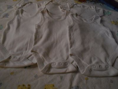 6 Lovely White Body Suits/Vests. Size. Up To 3 Mths