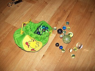 Glass marbles with bag, approx 100