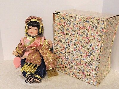 """Show Stopper Inc """"Joy"""" Style F830 Seated Porcelain Oriental Little Girl Doll New"""