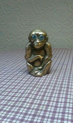 Antique brass monkey spill holder ornament with glass eyes