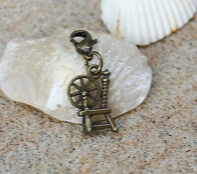 Spinning wheel vintage insired  bronze tone clip on charm zipper pull charm New