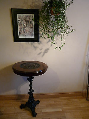Unique and unusual Vintage cast iron / wood table with Victorian coal hole cover