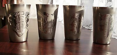 a set of 4 stainless steel beakers etched wildlife feature