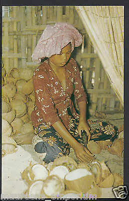 Malaya Postcard - A Malay Woman Labourer Peeling Coconut P735
