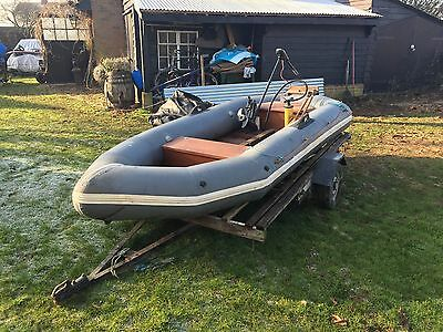 Inflatable Rib Boat With Yamaha M-20 Outboard & Trailer