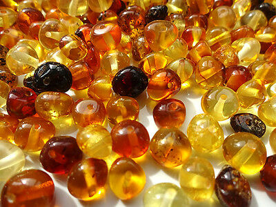 REAL POLISHED BALTIC AMBER HOLED LOOSE ROUND BEADS- 10gr !!!