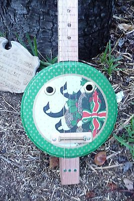 Guitar, 3 string cigar-box style biscuit tin guitar with pickup