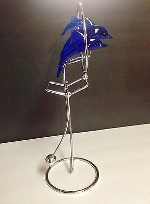 Cobalt Blue Lucite Dolphin Trio On A Silver Colored Stand With Motion Feature