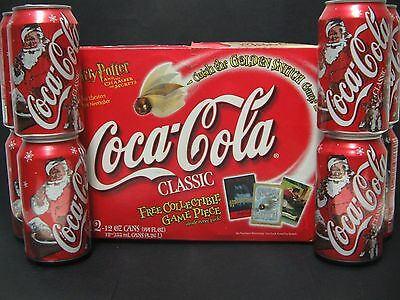 2002 Coca Cola Classic Santa Holiday Cans - 12 pack - opened - Harry Potter