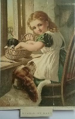 Adorable Victorian 1885 Card/ Picture. Beautiful child rocking a puppy to sleep.