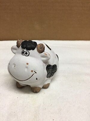 Clay Pottery Cow Figurine