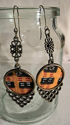 Brass Framed and Coined Kente