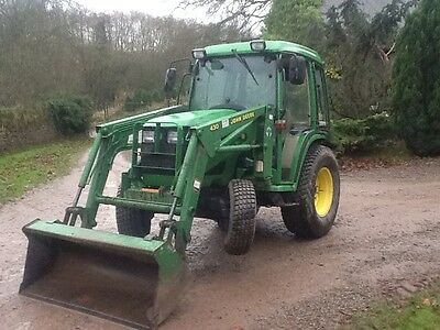 Diesel compact John Deere tractor with a 430 front loader with bucket,