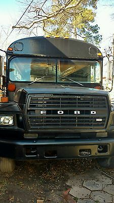 1983 Cool Black Ford full size bus