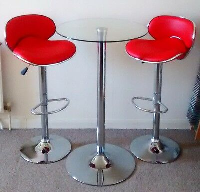Red Faux Leather and Chrome Bar Stools with Chrome and Glass Circular Table