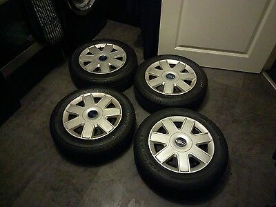 Set of 4 Ford fitment steel wheels and tyres.