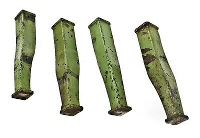 Four matching factory green cast iron curvaceous bases