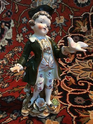 Porcelain Figurine with Gold Boy with bird Unknown Mark Dresden