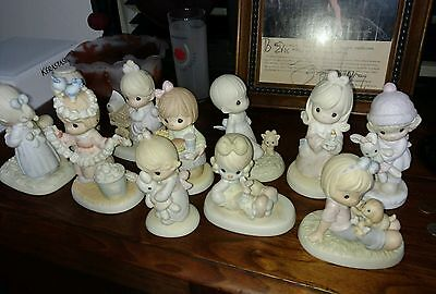 Lot of 11 precious moments figures