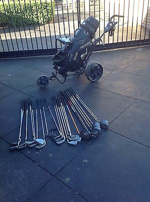 Golf Clubs And Buggy