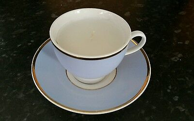 set of 2 handcrafted Doulton tea cups&saucer with a candle in baby blue & white