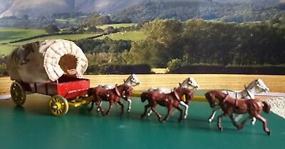 wild west covered wagon with horses