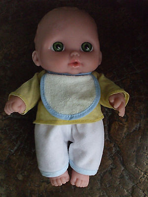 Berenguer baby doll 8 inches high, with free clothes