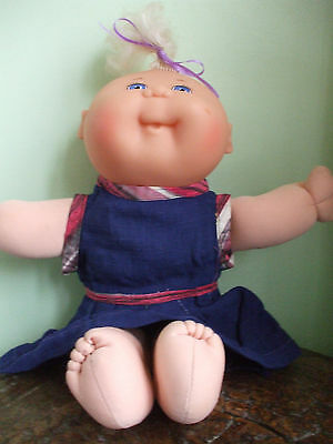 Cabbage Patch baby doll 13 inches high, with free clothes
