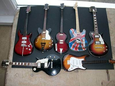 A Collection Of Novelty Guitars ( 7 )