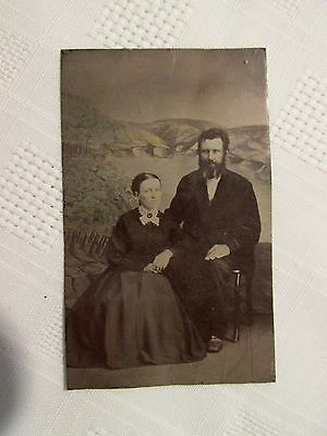 Vintage Tintype Photo of Man and Woman Scenic Backdrop