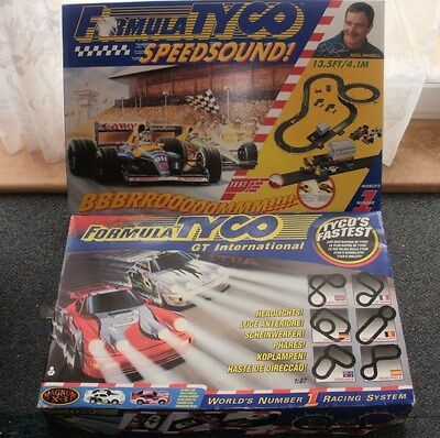 2 x Tyco slot car race sets plus extra cars and track