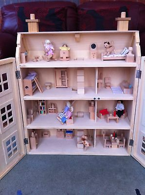 Wooden Dolls House - With indoor and outdoor Furniture, Family & Pet Animals