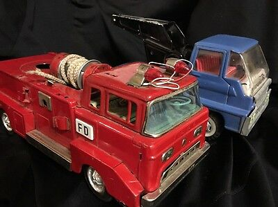 2 Tin Toys Vintage Retro For Parts Or Repair . Ford Fire Truck & Tiger Tow Truck