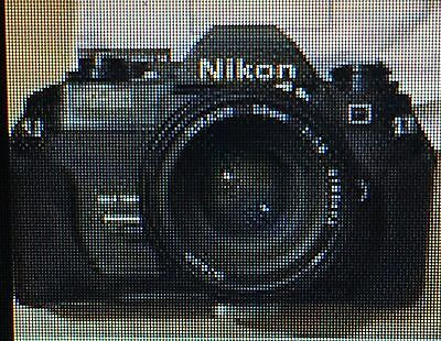 Camera Nikon FG20 and Nikon Nikkor 50mm f1.8 lens with filter and cover