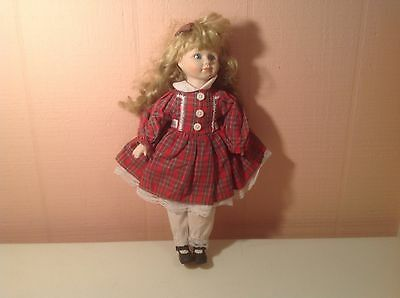 Vintage Madame Alexander Doll Wearing A Plaid Dress With Curls In Her Hair