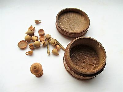 A vintage  small turned Oak lidded treen box with several tiny boxwood utensils