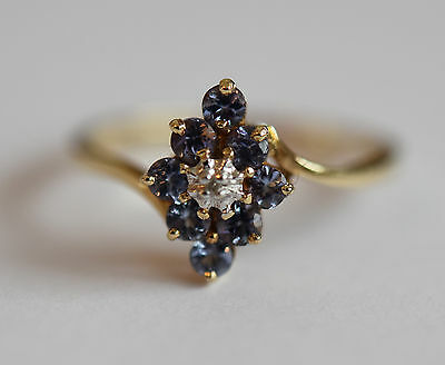 9ct gold tanzanite and diamond accent cluster ring