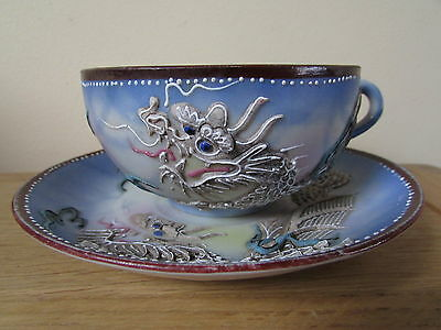 antique Japanese/Chinese fine porcelain cup & saucer with raised dragon, signed