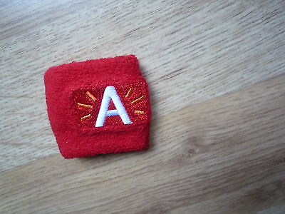 1x Wrist Sweatband, bright red with letter 'A'