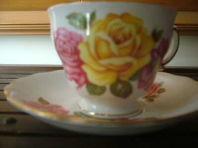 Royal Vale Bone China cup and saucer numbered,rose pattern.