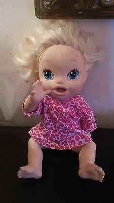 Blonde Baby Alive with pink leopard top