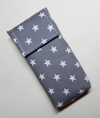 Handmade pocket tissue pouch. Grey cotton fabric with stars.Touch Tape closure.