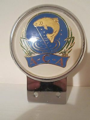 Vintage car badge with angling interest