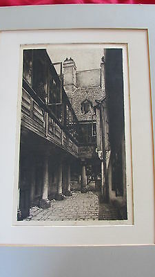 antique engraving of an old courtyard, signed, excellent perspective, tones etc