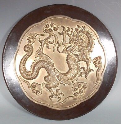 China Chinese Brass Plaque of a Relief Dragon on a Lacquered base ca. 20th c.