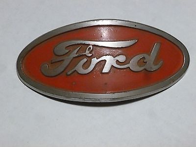 Original Ford Tractor Emblem 8N-16600. NOT a reproduction. Red enamel background
