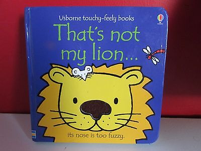 thats not my lion ( usborne touchy-feely books ) board book