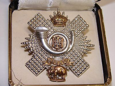 Officer's  Cap Badge The Highland Light Infantry, silver with 4 gilt overlays