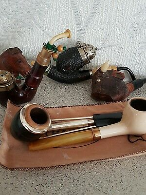 collection of antique pipes