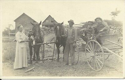 Vintage RP postcard of farming family in Canada